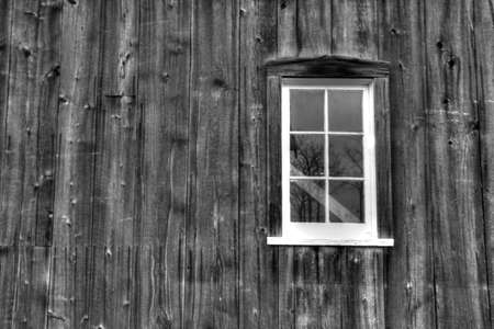 barn black and white: Black and white image of a vintage barn exterior and window  Pt  Sanilac Historical Village  Pt  Sanilac, Michigan