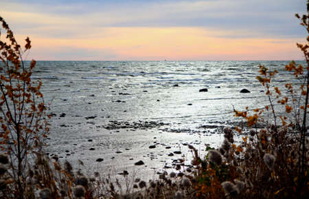 huron: Lake Huron waves sparkle as the sun rises and a new day begins