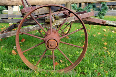 covered wagon: Worn and rusted wheel of a pioneer s covered wagon  Pt  Sanilac Historical Village  Pt  Sanilac, Michigan