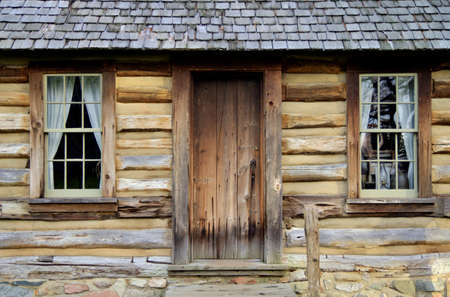 Front door and porch of a historical log cabin  Pt  Sanilac Historical Village  Pt  Sanilac, Michigan  photo