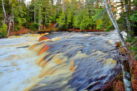 riverbed: White water crashes and cascades through the wilderness of the great north woods  Tahquamenon Falls State Park  Paradise, Michigan