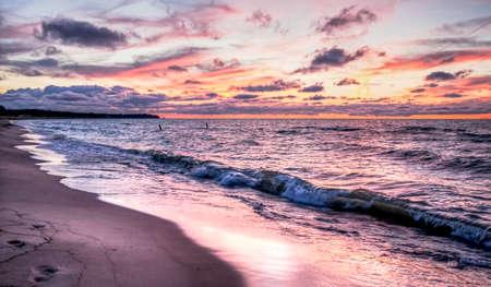 Gorgeous sunset colors over the Lake Huron horizon  Port Crescent State Park  Port Austin, Michigan