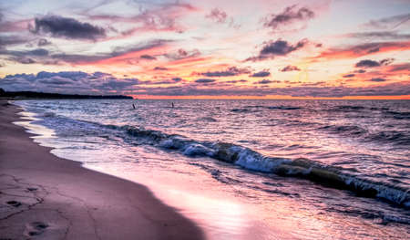 endings: Gorgeous sunset colors over the Lake Huron horizon  Port Crescent State Park  Port Austin, Michigan