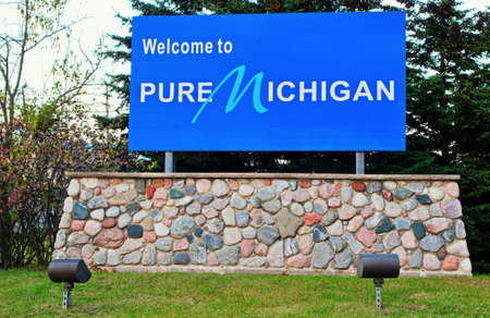 upper peninsula: Welcome To Michigan sign greets visitors as they enter the Great Lakes State