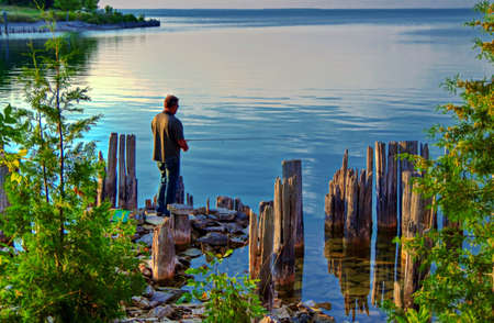 Shore fisherman with a gorgeous Lake Michigan in the background  Fayette Historic State Park  Fayette, Michigan