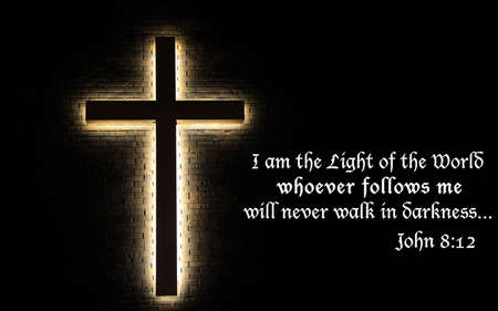 scripture: I Am The Light of the World  Illuminated cross on a brick wall, with scripture quote from the Book of John