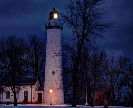 Point Aux Barques Lighthouse beacon lights up the cold and lonely winter s night  Lighthouse Park  Port Hope, Michigan  photo