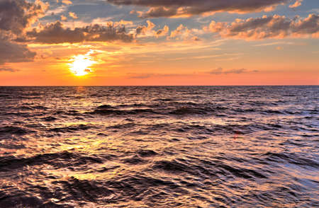 Infinity  Gorgeous sunset over the Great Lakes where the horizon meets the sky  Port Crescent State Park  Port Austin, Michigan   photo