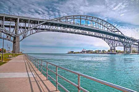 The twin spans of the Blue Water Bridges connect the cities of Port Huron, Michigan and Sarnia, Ontario  They are the second busiest crossing between the two countries with the Ambassador Bridge in Detroit being the busiest   photo