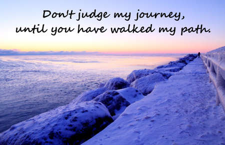 Don t Judge My Journey  A frozen landscape with a distant silhouette of a single person walking a slippery path  photo