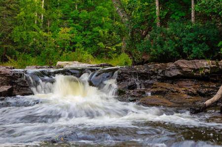 Big Eric Falls cascades through the northern woodlands photo