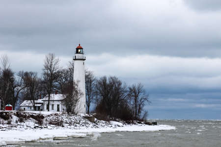 huron: Point Aux Barques Lighthouse beacon sweeps over the icy waters of Lake Huron  Lighthouse Park  Port Hope, Michigan   Stock Photo