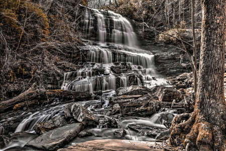 Waterfall cascades through the beautiful Smoky Mountains in North Carolina   photo