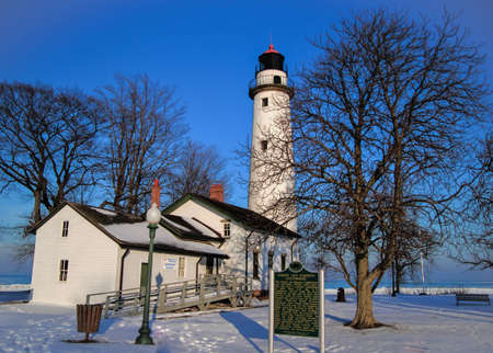 michigan snow: Point Aux Barques Lighthouse on a sunny winters day  Lighthouse Park  Port Hope, Michigan