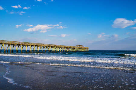 Pier juts into the deep blue waters of the Atlantic Ocean  photo