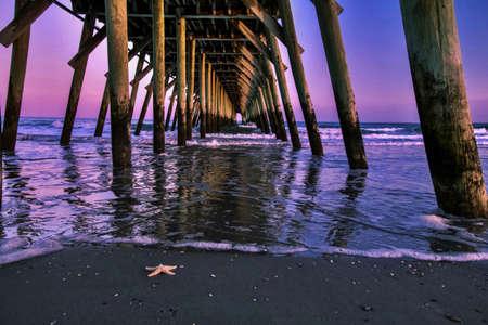 hdr background: Beach Pier with an Atlantic Ocean sunrise as the backdrop  Myrtle Beach, South Carolina  Stock Photo