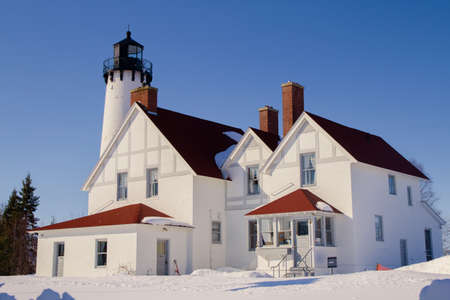 The Point Iroquois Lighthouse on the shores of remote Lake Superior  The lighthouse is part of the Whitefish Bay Scenic Byway within the Hiawatha National Forest  photo