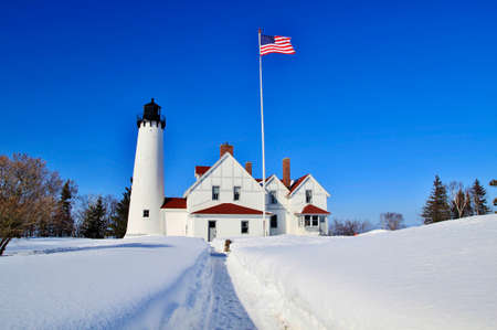 whitefish: The Point Iroquois Lighthouse on the shores of remote Lake Superior  The lighthouse is part of the Whitefish Bay Scenic Byway within the Hiawatha National Forest  Brimley, Michigan   Stock Photo