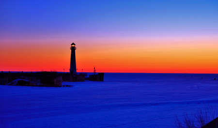Sunrise at the Chief Wawatam Lighthouse in St  Ignace, Michigan   photo