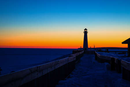 michigan snow: The Wawatam Lighthouse at sunrise along the shores of beautiful St Ignace in Michigan s beautiful Upper Peninsula Stock Photo