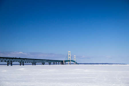upper peninsula: The Mackinaw Bridge caught in the icy grip of a historically cold winter   Stock Photo