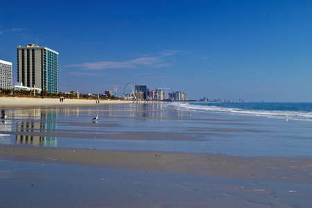 grand strand: The wide sandy beaches of Myrtle Beach, South Carolina otherwise known as the Grand Strand  One of the most popular vacation destinations along the eastern seaboard   Stock Photo