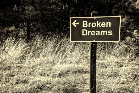 heartbreak issues: Wooden sign with arrow pointing the way to broken dreams
