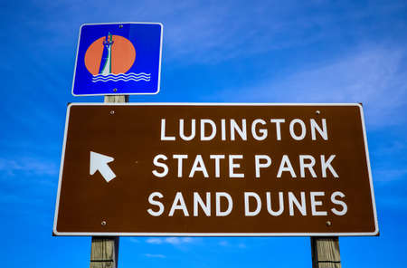 Directional sign pointing the way to Ludington State Park; the most popular state park in the state of Michigan