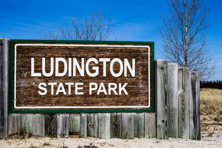 ludington: Welcome To Ludington State Park  Ludington State Park welcome sign; Michigan s most popular state park  Ludington State Park is considered to be one of the premier state parks in the Midwest   Stock Photo