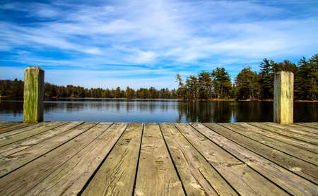 Wooden dock overlooking a gorgeous lake in the wilderness  Ludington State Park  Ludington, Michigan   Stock Photo