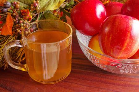 harvest background: Fresh glass of apple cider and bowl of apples with harvest background  Stock Photo