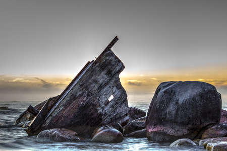 Wooden shipwreck beached on the rocky shore  Lexington County Park  Lexington, Michigan   photo