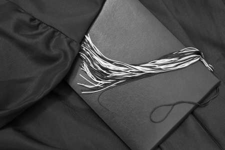 signify: Graduation Day  Gown, diploma and tassel signify one of life s greatest achievements