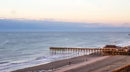 Birds eye view of the Atlantic Ocean horizon with a pier jutting into the ocean  Myrtle Beach, South Carolina   photo