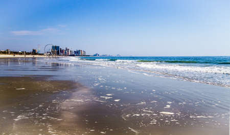 Atlantic Ocean shore with the downtown Myrtle Beach skyline in the distance Myrtle Beach, South Carolina
