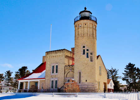 straits: Old Mackinaw Point Lighthouse has stood guard over the Straits of Mackinaw for over a century   Stock Photo