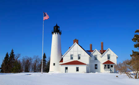 Point Iroquois Lighthouse located along the remote shores of Lake Superior photo