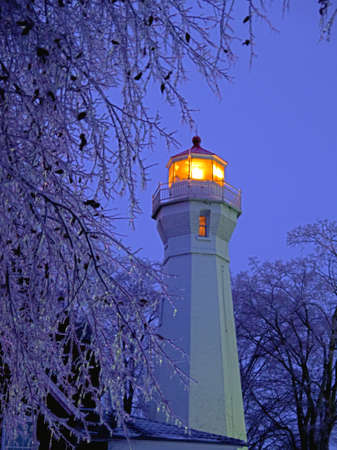 The Port Sanilac Lighthouse on a cold winter s eve