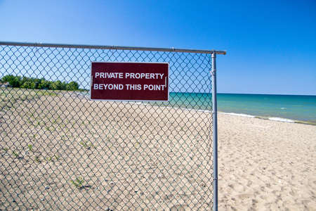 Private Property sign and chain link fence deter would be trespassers   photo
