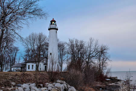 huron: The Pt  Aux Barques lighthouse beacon shines along the lonely Lake Huron shore  Lighthouse Park  Port Hope, Michigan   Stock Photo
