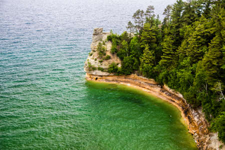 pictured: Miners Castle along the shores of Lake Superior is the most popular overlook located in Pictured Rocks National Lakeshore  Munisng, Michigan,  Stock Photo