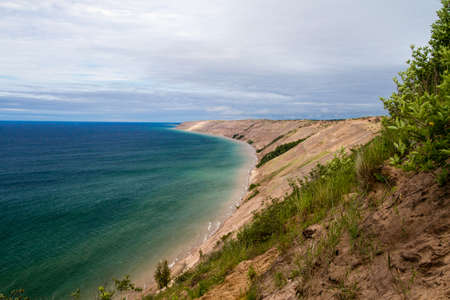 upper peninsula: The Log Slide Overlook in Pictured Rocks National Lakeshore with sand dunes that tower over 200 feet above the shores of Lake Superior   Stock Photo