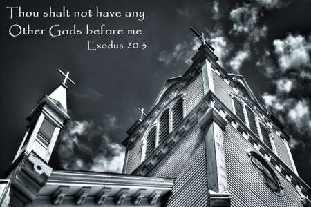 Church exterior with moody sky and bible verse   photo