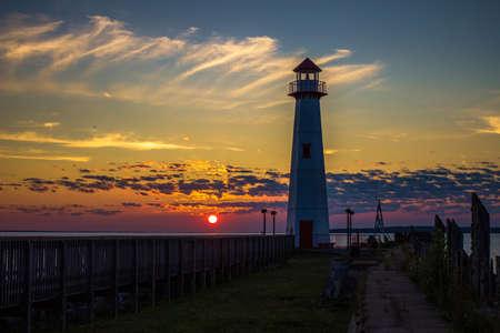 Sunrise along the St  Ignace boardwalk with the Wawatam Lighthouse  St  Ignace, Michigan   photo