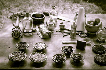 Nature s Pharmacy    Vintage pharmaceutical tools surrounded by herbs and tonics