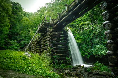 harnessing: Harnessing Energy. Water flows down a flume to power an 18th century grist mill. Great Smoky Mountains National Park. Gatlinburg, Tennessee.