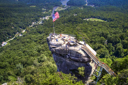 Chimney Rock State Park overlook with Lake Lure in the background. Chimney Rock, North Carolina.