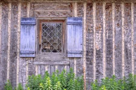 state owned: Cottage exterior with shuttered window. Fort Michimilimackinaw. Mackinaw City, Michigan. (This is not a privately owned residence. It is a public building in a state park.)