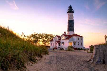 The Big Sable Lighthouse illuminated by the golden rays of the setting sun photo