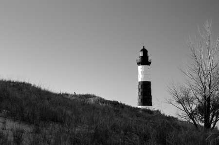 The Big Sable Lighthouse towers over the Lake Michigan sand dunes. photo